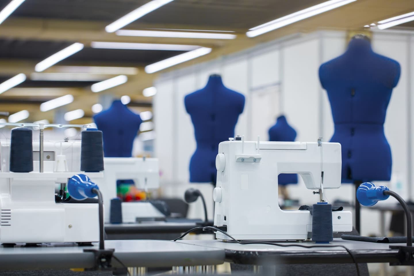 Sewing machines with body forms