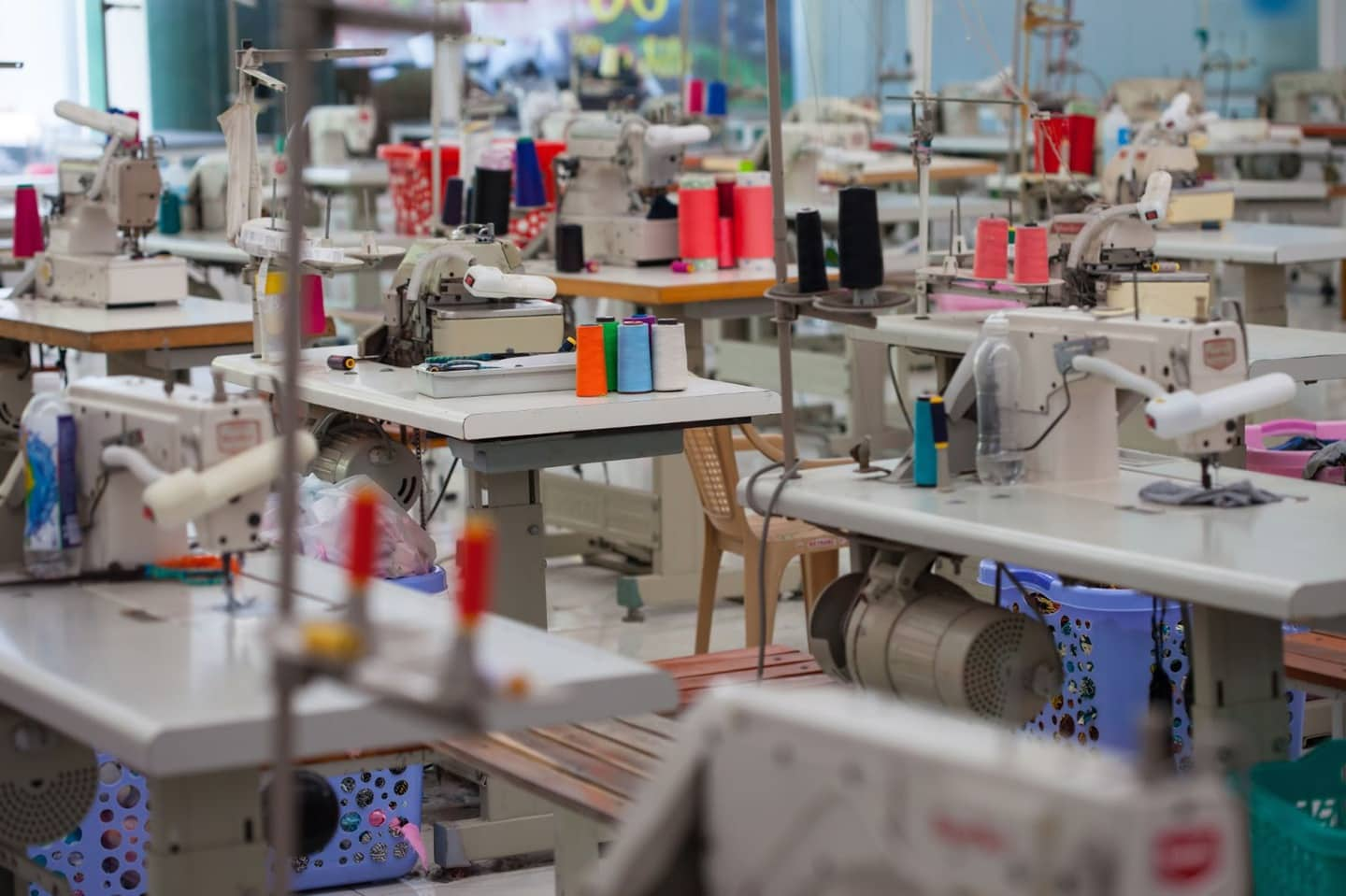 Sewing machines in a sew contractor facility