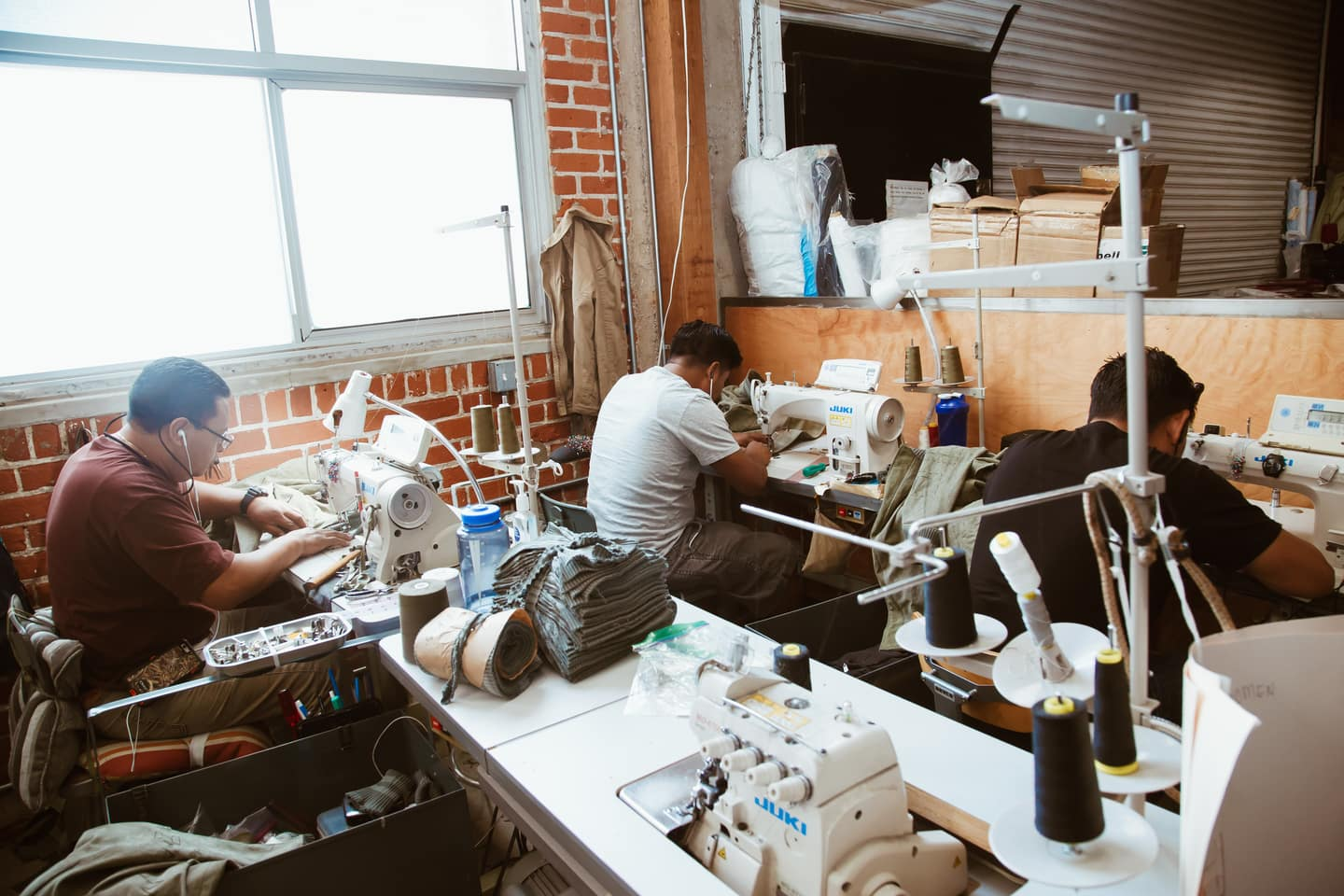 Three People Working in Clothing Manufacturing Office