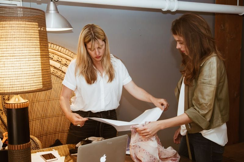 Designers measuring garments