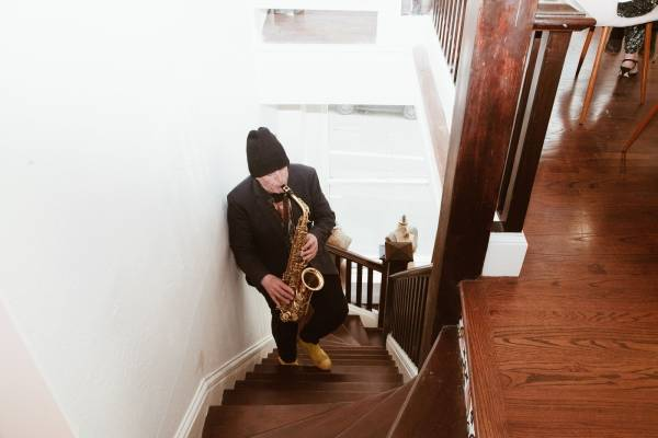 Playing Sax on Stairs