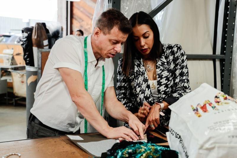 Designer explaining her ideas to patternmaker