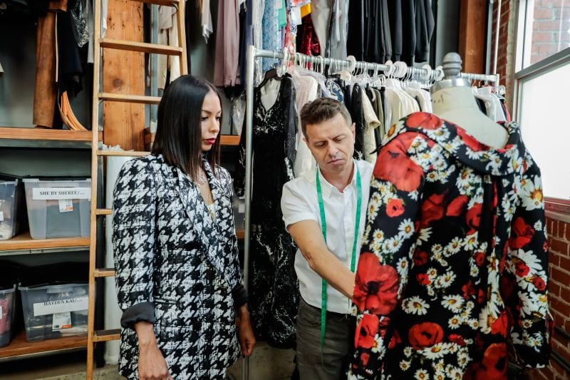 Designer reviewing her collection with pattern maker