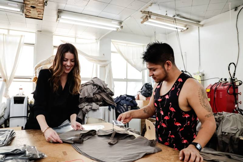 Clothing manufacturing experts working on a project
