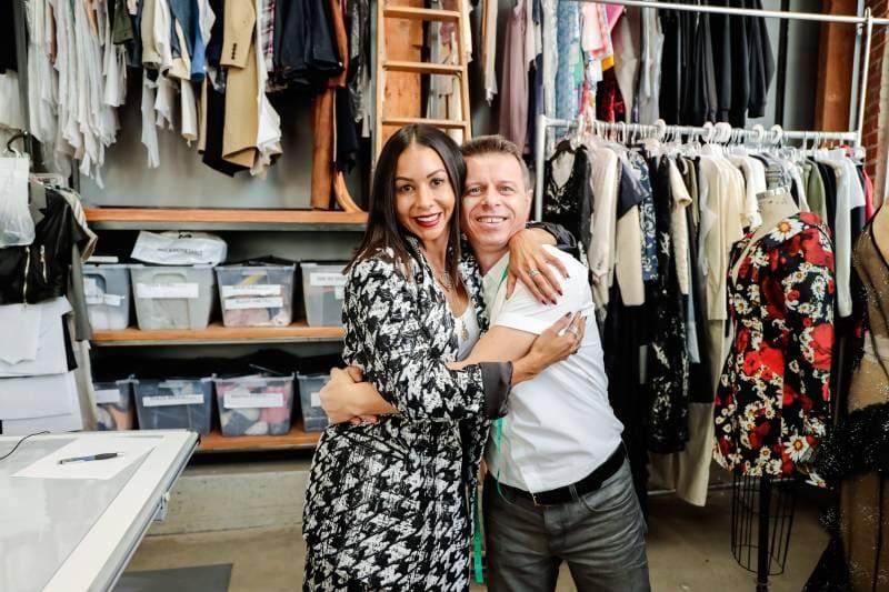 Designer and pattern maker hugging
