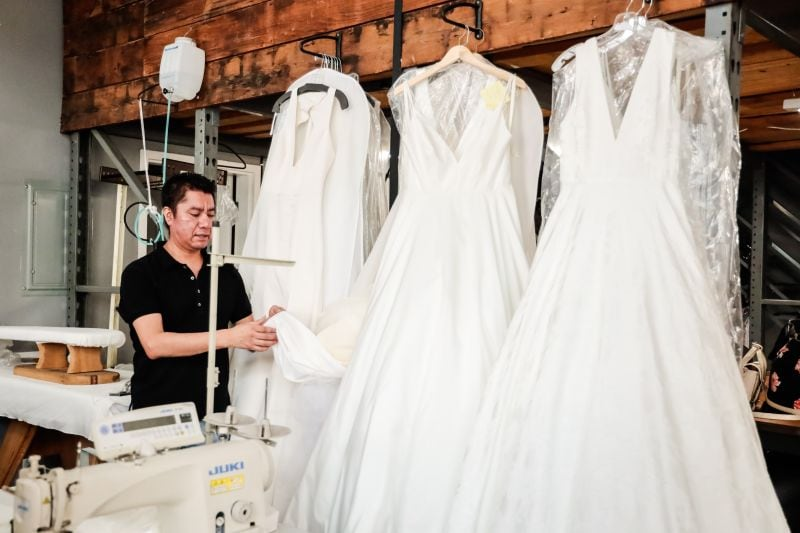 Samplemaker with delicate bridal gowns