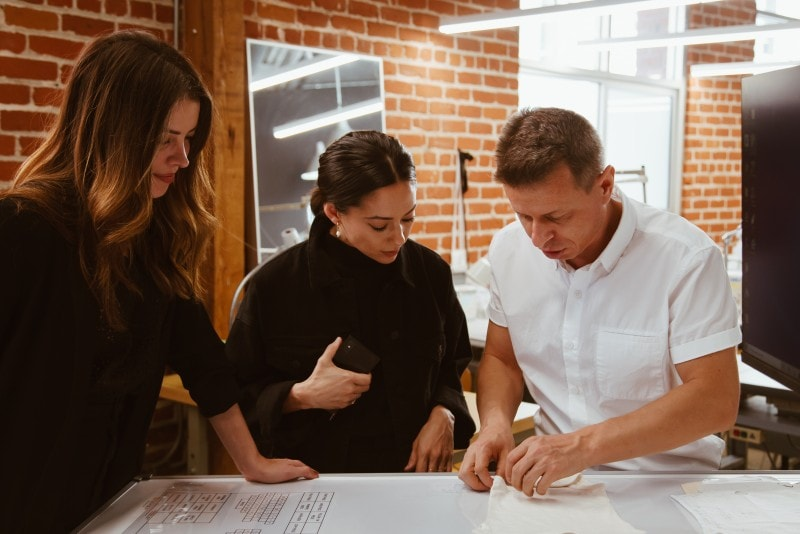 sourcing managers checking fabric quality