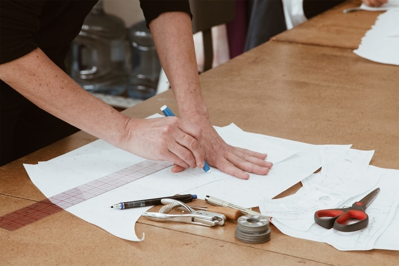 Man drafting a pattern on paper
