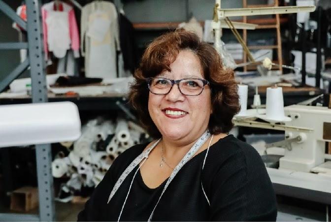 TEG seamstress smiling