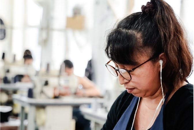 Seamstress studying specifications to start a clothing line