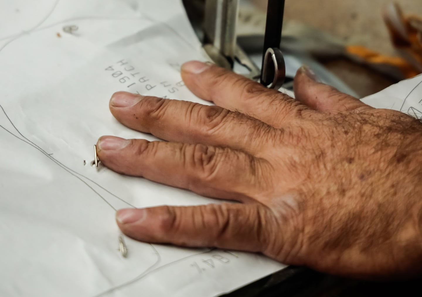 Closeup of Los Angeles clothing manufacturer's hand sewing fabric