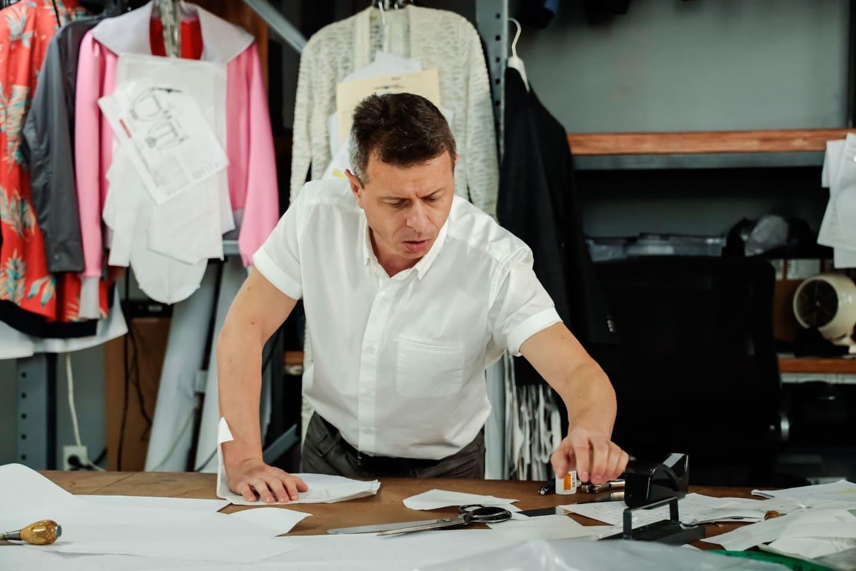 clothing manufacturer working on measuring clothing