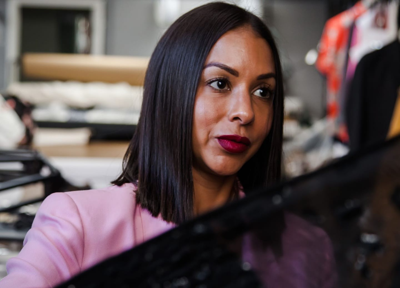 closeup of female fashion designer examining fabric for designing clothes
