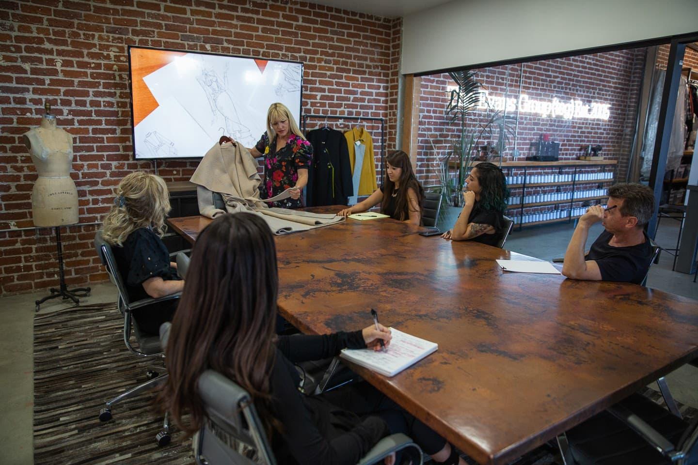 Jennifer Evans and TEG begin clothing design process in board room