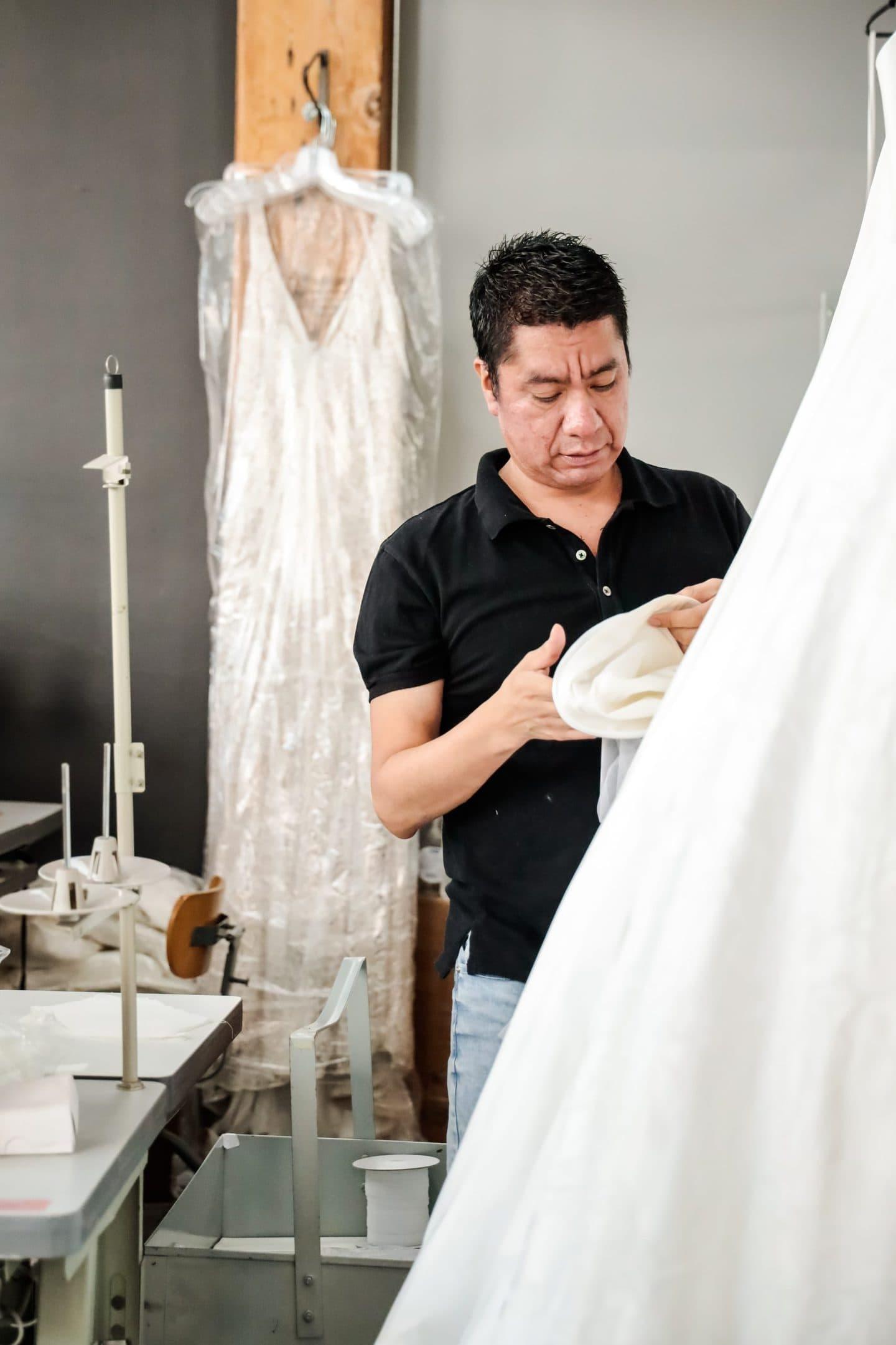 A Los Angeles pattern maker examining bespoke clothing