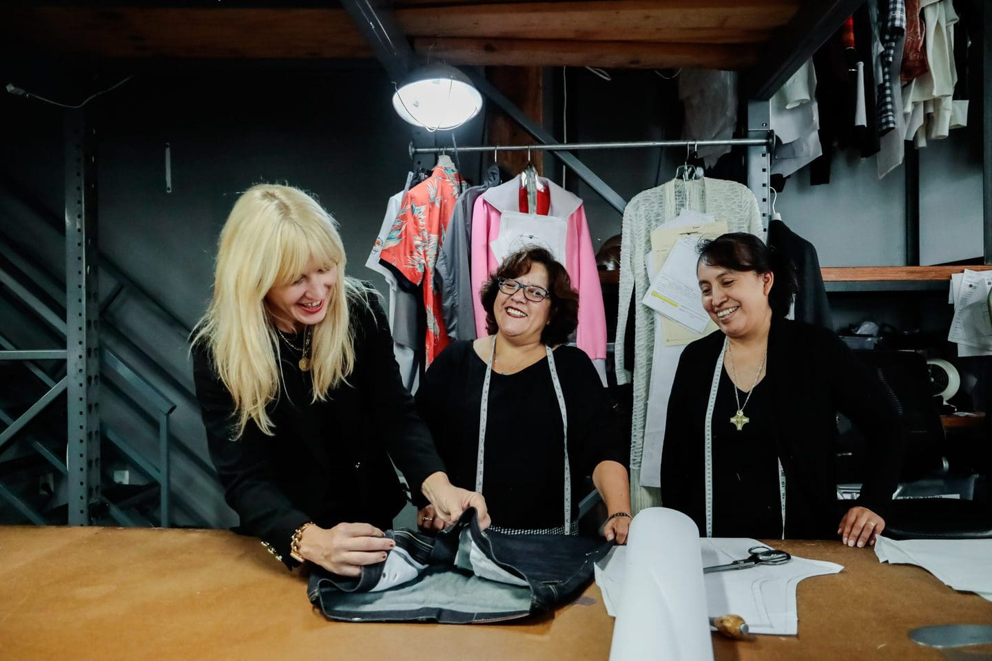 Jennifer Evans and two Los Angeles clothing manufacturers looking at new clothing made with natural fibers