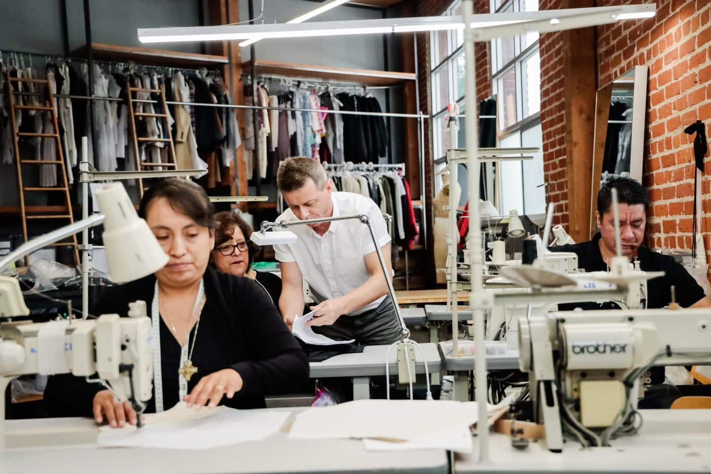 Team of clothing manufacturers working at sewing machines in the TEG Los Angeles clothing factory