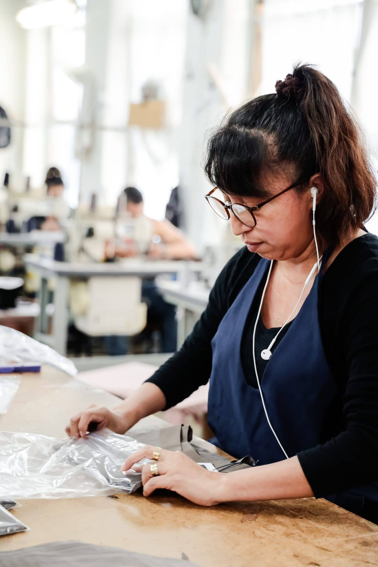 A Los Angeles seamstresses working on wrapping up sustainable fashion items