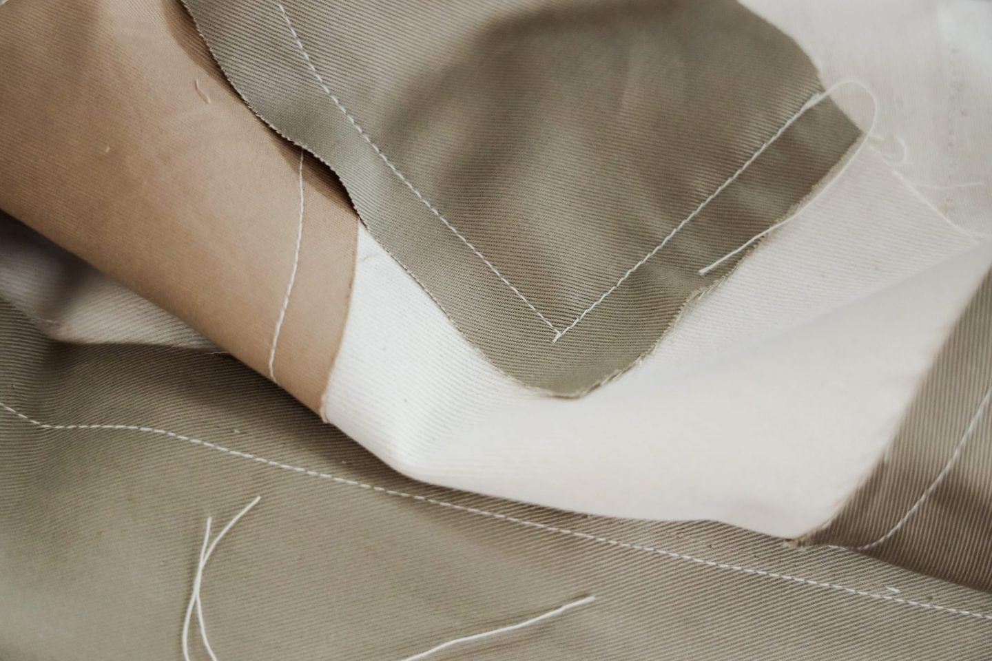 Closeup of tan fabric sewn by a Los Angeles sample maker
